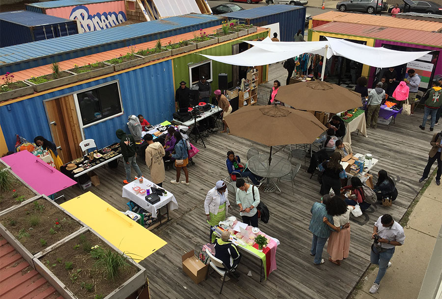 PeopleAtOpenAirMarketMadeFromShippingContainers