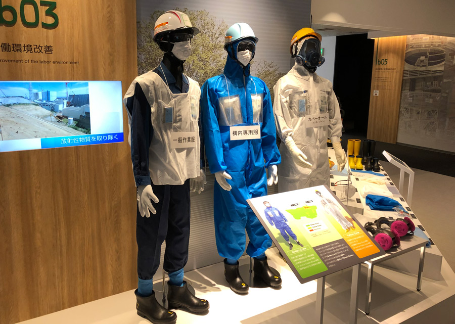 Exhibition_With_Protective_Gear_Worn_By_Workers_At_Fukushima