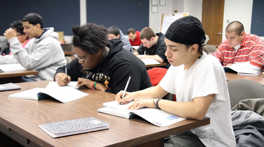 ClassroomOfStudentsStudyingAndWorkingOnHomework