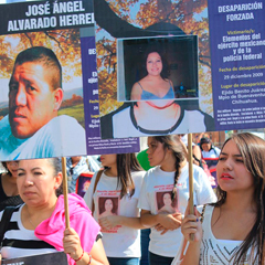MexicanPeopleMarchingTogetherHoldingSignsOfMissingPeople