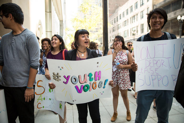 Mikva Challenge youth protesting on the sidewalk