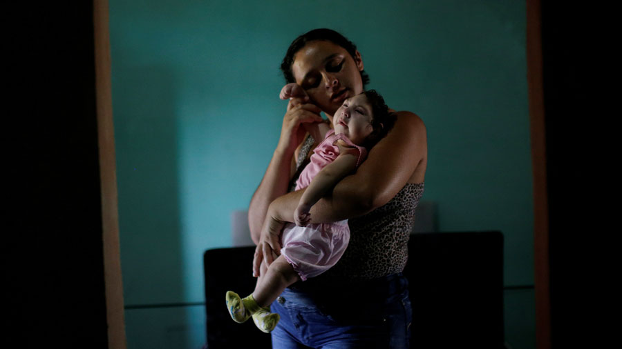 Mother-with-baby-Zika