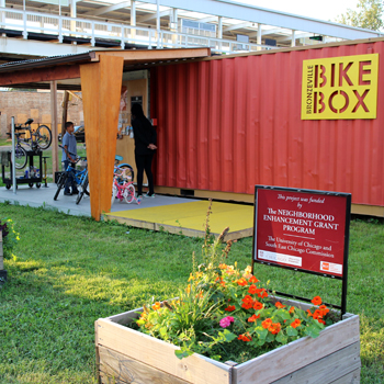 Small building next to train tracks for bike program